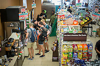 A busy 7-Eleven store on Free Slurpee Day in New York on Saturday, July 11, 2015 (7-11, get it?). The 7-Eleven self-proclaimed Free Slurpee Day has been a yearly event for the past 13 years giving away free 7oz Slurpees. The popular icy, slushy, syrupy drinks are available in regular and diet flavors, in combinations, and the stores have stocked up with extra barrels of syrup to meet the expected demand. The 88 year old chain expects to serve over 8 million Slurpees today. (© Richard B. Levine)