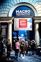 Opening night at Macro Contemporary Art Centre in the Testaccio district of Rome. The former abattoir, is now home to contemporary art exhibits as well as organic markets, cafes, workshops and art exhibits.