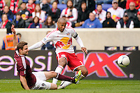 Thierry Henry (14) of the New York Red Bulls shoots and scores his second goal of the game. The New York Red Bulls defeated the Colorado Rapids 4-1 during a Major League Soccer (MLS) match at Red Bull Arena in Harrison, NJ, on March 25, 2012.
