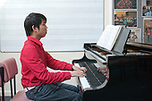 English as a Foreign Language student on the piano, Further Education College.