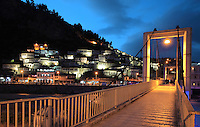 The bridge over the Osum river at night time, with houses of the Mangalem quarter lit up, in Berat, South-Central Albania, capital of the District of Berat and the County of Berat. In July 2008, the old town (Mangalem district) was listed as a UNESCO World Heritage Site. Picture by Manuel Cohen