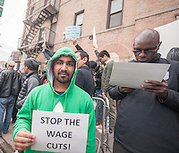 Several hundred Uber drivers and their supporters strike in front of Uber's Queens offices in New York on Monday, February 1, 2016. The drivers are upset over Uber's recent 15% cut in fares meaning less money for the drivers. Uber claims that the cut will increase volume and the drivers will have less down-time.   (© Richard B. Levine)