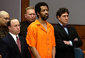 Manassas, VA - March 9, 2004 -- Convicted Beltway Sniper John Allen Muhammad, center, stands emotionless with his attorneys Peter Greenspun, left, and Jonathan Shapiro, right,  as he is sentenced to death for the shooting of Dean Meyers at the Prince William County (Virginia) Circuit Court in Manassas, Virginia on March 9, 2004.  A Virginia Beach, Virginia jury convicted Muhammad and reccommended the death sentence for his role in the fall, 2002 DC Sniper shootings. .Credit: Steve Helber - Pool via CNP