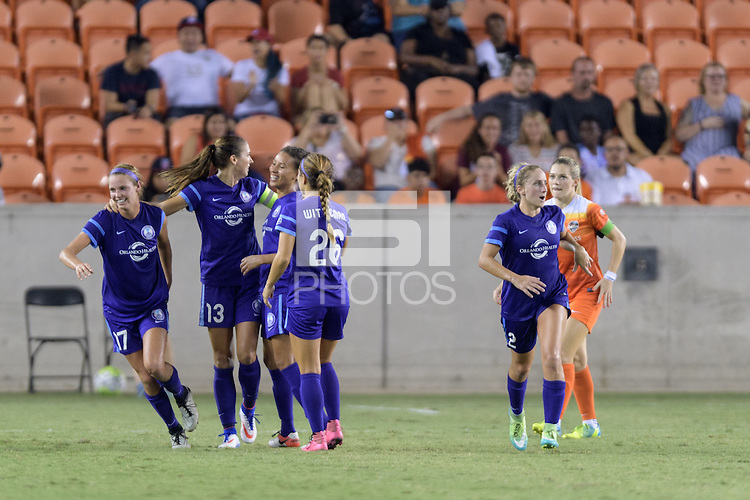 Houston, TX - Saturday Sept. 03, 2016: Dani Weatherholt, Alex Morgan celebrates scoring, Samantha Witteman during a regular season National Women's Soccer League (NWSL) match between the Houston Dash and the Orlando Pride at BBVA Compass Stadium.