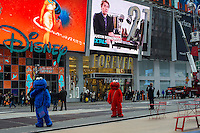 """Costumed characters seen in Times Square in New York on Monday, January 21, 2013. The """"actors"""" pose for photographs with tourists asking for tips as renumeration.  (© Frances M. Roberts)"""