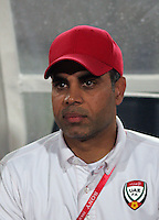 United Arab Emirates' Head Coach Mahdi Redha watches his team before the match against Cost Rica during the FIFA Under 20 World Cup Quarter-final match at the Cairo International Stadium in Cairo, Egypt, on October 10, 2009. Costa Rica won the match 1-2 in overtime play.