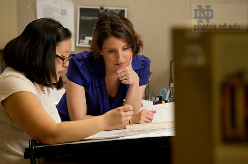Mar. 30, 2011; Aimee Buccalletto goes over drawings in the 5th-year studio...Photo by Matt Cashore/University of Notre Dame