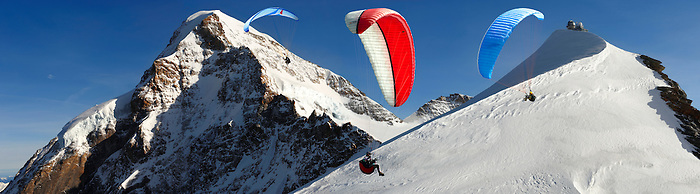 Paragliders near the Observatory at the Jungfrau Top of Europe - Swiss Alps - Switzerland