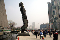 "A sculpture stands high above crowds as they enter the Memorial Hall of the Nanjing Massacre in Nanjing, China, on Thursday, Dec. 13, 2007. After two years of renovations, the Memorial Hall of the Nanjing Massacre reopened to the public on Dec. 13, 2007, the 70th anniversary of the 6-week massacre by Japanese troops that started Dec. 13, 1937 and claimed more than 300,000 lives.  The commemoration comes amid renewed controversy about the accuracy of historical accounts of the massacre.  The massacre is also known as ""The Rape of Nanking."""
