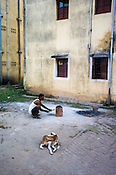 A resident lights up the coal stove outside his flat in Belgharia township outside of Dhanbad in Jharkhand, India. Families from various villages with underground fires have been rehabilitated in Belgharia township. Photo: Sanjit Das/Panos