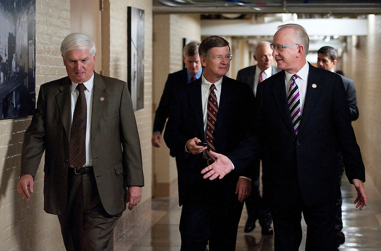 "UNITED STATES - SEPTEMBER 21: From left, Rep. John ""Jimmy"" Duncan, R-Tenn., Rep. Lamar Smith, R-Texas, and Rep. Howard ""Buck"" McKeon, R-Calif., arrive for the House Republican Conference meeting in the Capitol on Wednesday,  Sept. 21, 2011. (Photo By Bill Clark/Roll Call)"