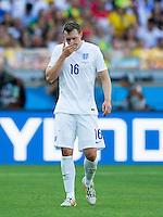 Phil Jones of England looks dejected