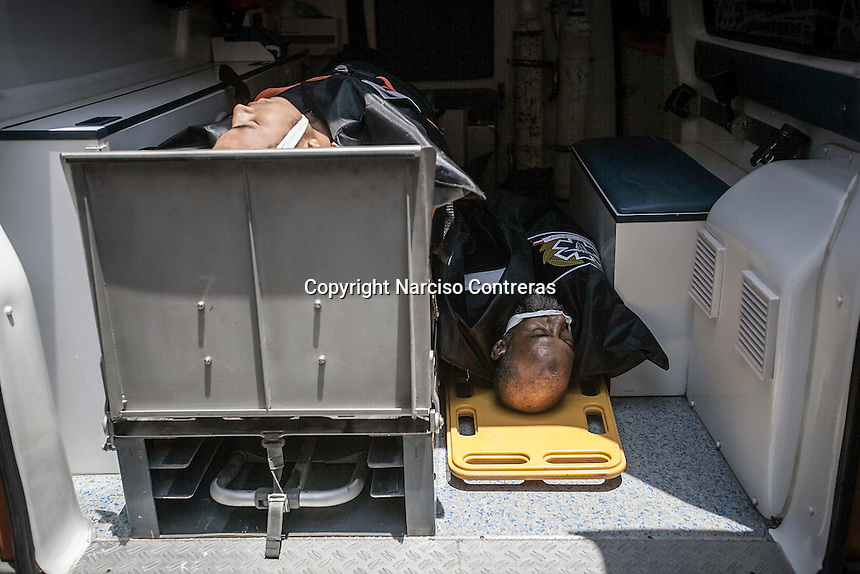 In this Monday, Jul. 08, 2013 photo, dead bodies are seen laying down inside an ambulance as they arrive to the morgue from Republican Guard heardquarters were got shot allegedly by Egyptian army forces in Cairo, Egypt. (Photo/Narciso Contreras).
