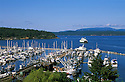 Boats in marina and ferry in bay at Friday Harbor on San Juan Island, Washington.