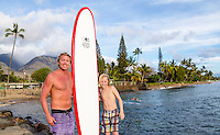 A father and son with their surfboard in Lahaina, Maui.