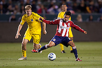 Midfielder Gerson Mayen (14) of Chivas USA navigates through the Crew defence. Chivas USA and Columbus Crew played to a 0-0 tie at Home Depot Center stadium in Carson, California on  April  9, 2011....