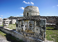 Mask of Chaac, God of the rain, Room of the Masks with the Round Temple called the Observatory in the distance, Mayapan, old Maya capital, c. 1250, destroyed during civil war, 1441, Yucatan, Mexico. Picture by Manuel Cohen