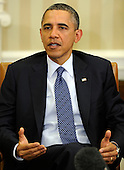 United States President Barack Obama makes remarks to the press after a bilateral meeting with President Mikheil Saakaskvili of Georgia (not pictured), in the Oval Office of the White House, January 30, 2012, Washington, DC. The two leaders discussed Georgia's contributions to security in Afghanistan as well as mutual cooperation in trade, tourism, energy, science and culture.  .Credit: Mike Theiler / Pool via CNP
