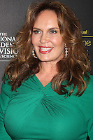 LOS ANGELES - JUN 23:  Catherine Bach arrives at the 2012 Daytime Emmy Awards at Beverly Hilton Hotel on June 23, 2012 in Beverly Hills, CA
