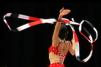 Stela Sultanova of Bulgaria turning with ribbon at World Games from Duisburg, Germany on July 21, 2005.  Event finals in rhythmic gymnastics are only held at World Games. <br />