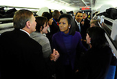 Baltimore, MD - January 17, 2009 -- United States President-elect Barack Obama's wife Michelle greets train riders as Obama's watches on during the Whistle Stop Train Tour, outside of Baltimore, Maryland on Saturday, January 17, 2009. The ceremonial trip will carry President-elect Obama, Vice President-elect Biden and their families to Washington for their inaugurations with additional events in Philadelphia, Wilmington and Baltimore. Obama will be sworn in as the 44th President of the United States on January 20, 2009..Credit: Kevin Dietsch - Pool via CNP