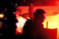 Roma 18 Aprile 2010. Scontri tra tifosi alla fine del derby di calcio  Lazio vs Roma .Le forze dell'ordine  disperdono i tifosi sul lungotevere di fronte alla stadio Olimpico..Rome April 18, 2010. Clashes between fans at the end of football derby Lazio vs Roma.The police dispersed the fans in front of the Olympic Stadium.