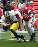 November 22, 2008. Ohio State defensive lineman Dexter Larimore sacks Michigan quarterback Nick Sheridan. The Ohio State Buckeyes defeated the Michigan Wolverines 42-7 on November 22, 2008 at Ohio Stadium, Columbus, Ohio.