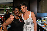 Makeup artist poses with model before the Francis Hendy Spring 2012 mens fashion show in the Samsung Experience, during New York Fashion Spring 2012, on September 8, 2012.