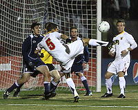 Doug Rodkey #5 of the University of Maryland blasts a shot towards Andres Casais #6 and Brendan Birmingham #28 of Penn State during an NCAA 3rd. round match at Ludwig Field, University of Maryland, College Park, Maryland on November 28 2010.Maryland won 1-0.