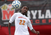 COLLEGE PARK, MD - OCTOBER 28, 2012:  Shade Pratt (22) of the University of Maryland heads the ball against Miami during an ACC  women's tournament 1st. round match at Ludwig Field in College Park, MD. on October 28. Maryland won 2-1 on a golden goal in extra time.