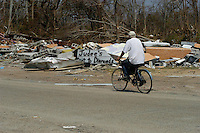 A man rides his bike on Coleman Avenue in Waveland Mississippi two days after Hurricane Katrina destroyed the neighborhood.