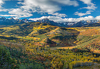 Uncompahgre National Forest, Colorado: Morning light on Mount Sneffels with fall colored aspens and pines in the valley of East Dallas Creek