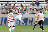 Houston, TX - Friday December 11, 2016: Corey Baird (10) of the Stanford Cardinal heads the ball away from his goal against the Wake Forest Demon Deacons at the NCAA Men's Soccer Finals at BBVA Compass Stadium in Houston Texas.