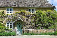Traditional Cotswold stone wysteria-clad cottage in the quaint village of Eastleach Turville in the Cotswolds, Gloucestershire, UK