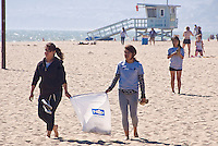 Venice High School students Alejandra Martinez, 16, (left)  and Evelyn Dumas, 15, pick up litter at Santa Monica Beach on Wednesday, May 25, 2011.They were here on a Heal the Bay school field trip.