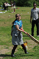 NWA Democrat-Gazette/ANDY SHUPE<br /> Thy Dao, a University of Arkansas student from Vietnam, laughs Saturday, April 8, 2017, as she tries her hand at cricket during a celebration of Vasant Utsav for University of Arkansas students in Wilson Park in Fayetteville. The traditional Hindu celebration marks the coming of spring and offers a break from studying to students so they can revere Saraswati, the goddess of knowledge and learning.