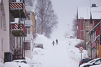 Children running in the snow in Tromso within the Arctic Circle in Northern Norway