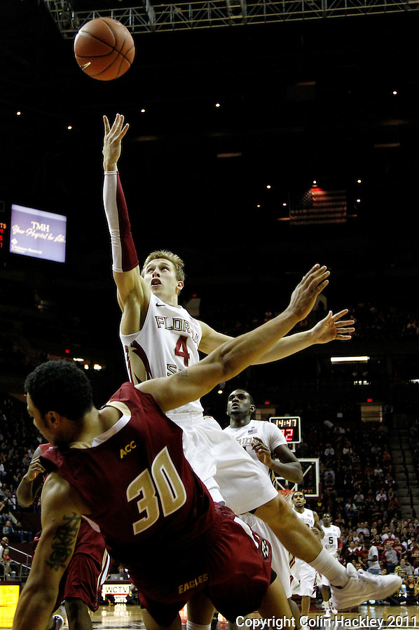 TALLAHASSEE, FL /1/22/11-FSU-BC MBB11 CH-Florida State's Deividas Dulkys sends Boston College's Dallas Elmore to the floor as he shoots during second half action Saturday at the Donald L. Tucker Center in Tallahassee. The Seminoles beat the Eagles 67-51...COLIN HACKLEY PHOTO