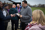 City of Liverpool 6 Holker Old Boys 1, 10/12/2016. Delta Taxis Stadium, North West Counties League Division One. A spectator buying a match programme at the Delta Taxis Stadium, Bootle, Merseyside before City of Liverpool hosted Holker Old Boys in a North West Counties League division one match. Founded in 2015, and aiming to be the premier non-League club in Liverpool, City were admitted to the League at the start of the 2016-17 season and were using Bootle FC's ground for home matches. A 6-1 victory over their visitors took 'the Purps' to the top of the division, in a match watched by 483 spectators. Photo by Colin McPherson.