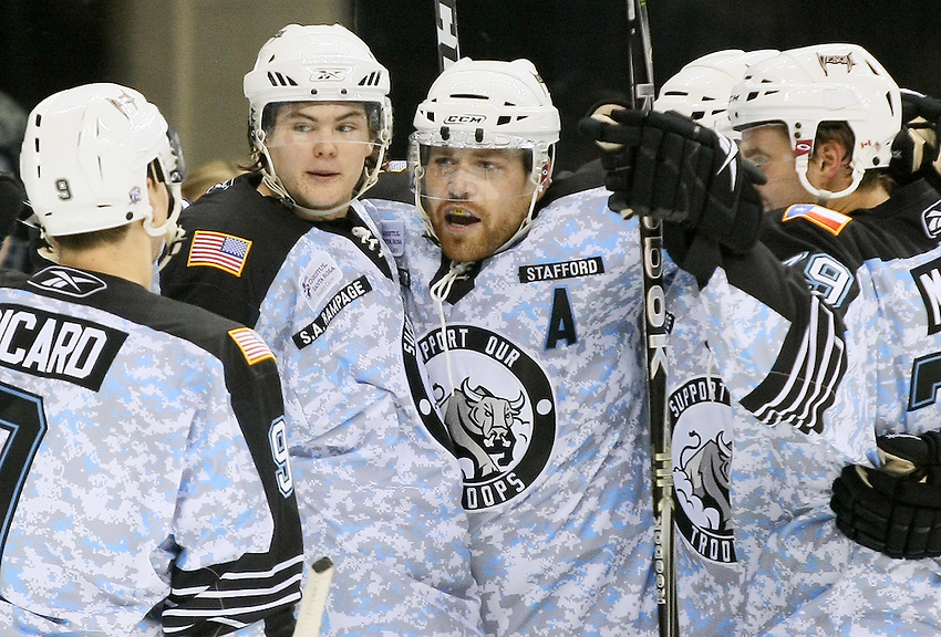 San Antonio Rampage players Alexandre Picard (L-R), Viktor Tikhonov, Garrett Stafford, and Brett MacLean celebrate a goal by Stafford in the second period of an AHL hockey game against the Texas Stars, Saturday, Feb. 26, 2011, in San Antonio. (Darren Abate/pressphotointl.com)