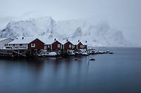 Traditional red seaside Rorbu cabins in winter, Hamnøy, Moskenesøy, Lofoten Islands, Norway