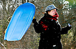 WATERBURY, CT 01 December 2008-010109SV02--Robyn O'Neill of Waterbury has trouble hanging onto her son's sled in the wind gusts at Fulton Park in Waterbury Thursday. Wind chill temperatures were around 0 degrees.<br /> Steven Valenti Republican-American