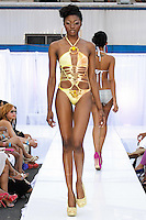 Model walks runway in a Silver Mosquito swimsuit by Pam John and Teri Ryan, during the JRG Bikini Under The Bridge 2012 fashion show on July 9, 2012.