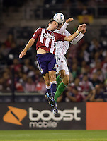 Chivas de Guadalajara midfielder Ulises Davila   battles with Chivas USA forward Alan Gordon. Chivas USA forwardLos CD Chivas  vs  at Petco Park stadium in San Diego, California on Tuesday September 14, 2010.
