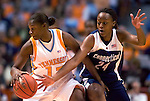 KNOXVILLE, TN--07 JANUARY 2005- 010706JS04-<br /> UConn's Charde Houston tries to strip the ball from Tennessee's Dominique Redding during their game  Saturday at the Thompson-Boling Arena in Knoxville, Tennessee. <br />  --Jim Shannon Republican American--UConn; Tennessee; Thompson-Boling Arena; Knoxville; Tennessee; Charde Houston,  Dominique Redding are CQ