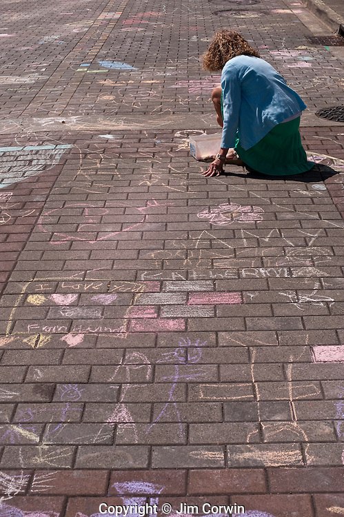 Chalk painting woman artist