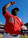 23 September 2007: Washington Nationals first baseman Dmitri Young tosses baseballs to fans celebrating a victory against the Philadelphia Phillies at Robert F. Kennedy Memorial Stadium in Washington, DC. The Nationals' 5-3 win was the historic last professional baseball game played at RFK Stadium.. .Mandatory Photo Credit: Ed Wolfstein Photo