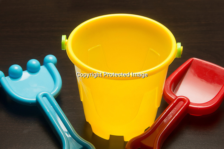 Colorful sand bucket and scoops for the beach.