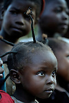 A girl in the Makpandu refugee camp in Southern Sudan, 44 km north of Yambio, where more that 4,000 people took refuge in late 2008 when the Lord's Resistance Army attacked their communities inside the Democratic Republic of the Congo. Attacks by the LRA inside Southern Sudan and in the neighboring DRC and Central African Republic have displaced tens of thousands of people, and many worry the attacks will increase as the government in Khartoum uses the LRA to destabilize Southern Sudan, where people are scheduled to vote on independence in January 2011. Catholic pastoral workers have accompanied the people of this camp from the beginning.