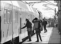 BNPS.co.uk (01202 558833)<br /> Pic: TheHistoryPress/BNPS<br /> <br /> Douglas Boyd was arrested at gunpoint where the two nearer commuters are getting on their morning train to work in Berlin<br /> <br /> A former spy has given a unique account of being held hostage in an East German prison and interrogated by the KGB in a new book.<br /> <br /> Ex-British agent Douglas Boyd was confronted by the KGB while enduring solitary confinement as a Cold War prisoner in a Stasi interrogation prison behind the iron curtain in 1959.<br /> <br /> KGB officers tried desperately to get him to break his cover - of a run of the mill clerk - and offered him a bogus deal in order to get him out of the prison so they could take him to a Gulag.<br /> <br /> The Solitary Spy, A Political Prisoner in Cold War Berlin, by Douglas Boyd, is published by The History Press and costs &pound;20.